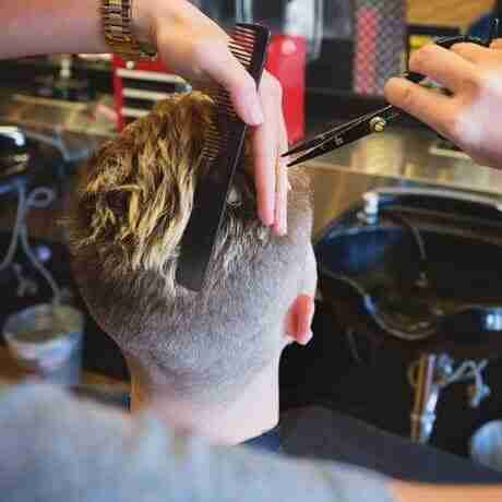 Men's-Haircut-remove-weight-with-scissors Judes-Barbershop